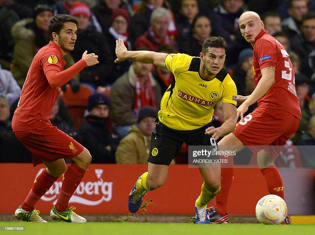 BSC Young Boys Argentinian forward Raul Bobadilla (C) vies with Liverpool's Turkish midfielder Nuri Sahin (L) and Liverpool's English midfielder Jonjo Shelvey (R) during the UEFA Europa League group A football match between Liverpool and BSC Young Boys at Anfield in Liverpool, north-west England on November 22, 2012.