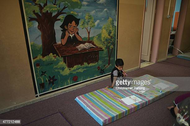 Young boys at the Alamal Institute for Orphans take part in a drawing class on June 14 2015 in Gaza City Gaza The number of children living at the...