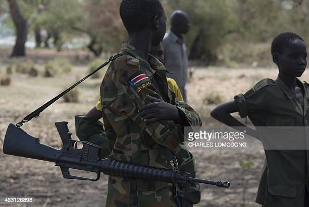 Young boys children soldiers attend on February 10 2015 a ceremony of the child soldiers disarmament demobilisation and reintegration in Pibor...