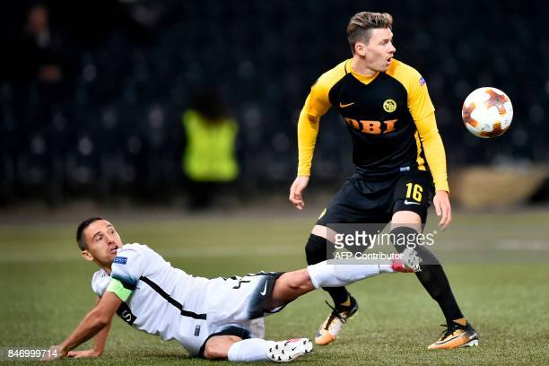 Young Boys' Christian Fassnacht vies for the ball with Partizan's Miroslav Vulicevic during the UEFA Europa League group stage football match between...