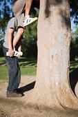 young boys climbing a tree