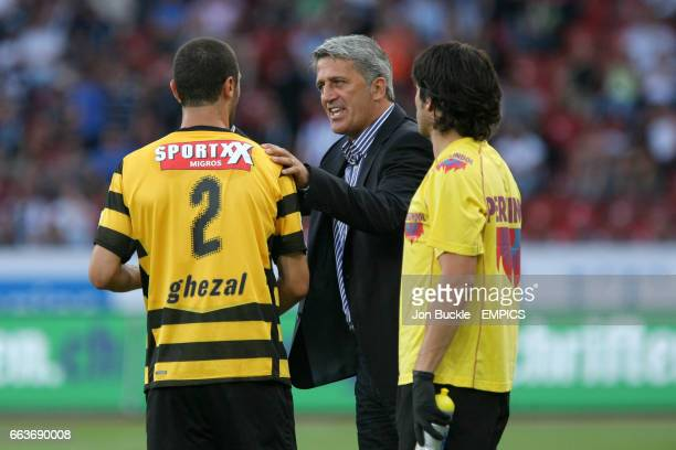 BSC Young Boys coach Vladimir Petkovic gives advice to Saif Ghezal on the touchline