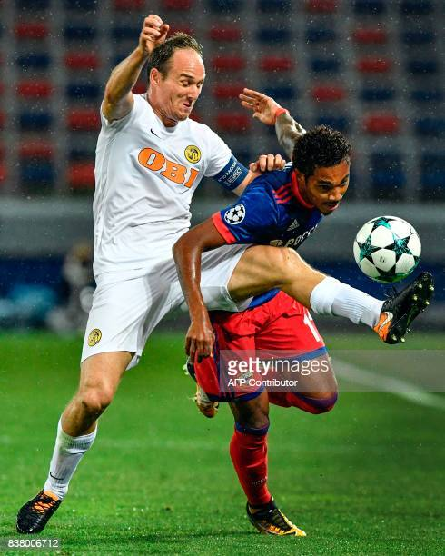Young Boys' defender Steve von Bergen vies CSKA Moscow's forward Vitinho for the ball during the UEFA Champions League play off second leg football...