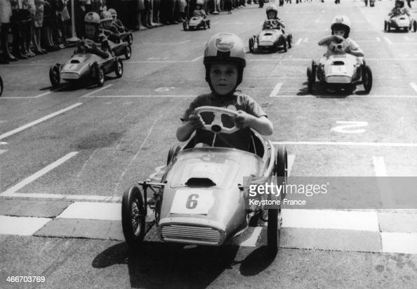 Young boys driving racing pedal cars during holiday contest on August 3 1968 in United Kingdom