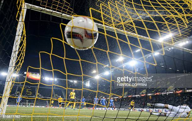 TOPSHOT Young Boys' French forward Guillaume Hoarau scores a penalty against APOEL'S Dutch goalkeeper Boy Waterman during the Europa League group B...