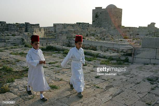 Young boys from the ancient Samaritan sect walk through the ruins of a Byzantine church after dawn prayers on the last day of their Passover...