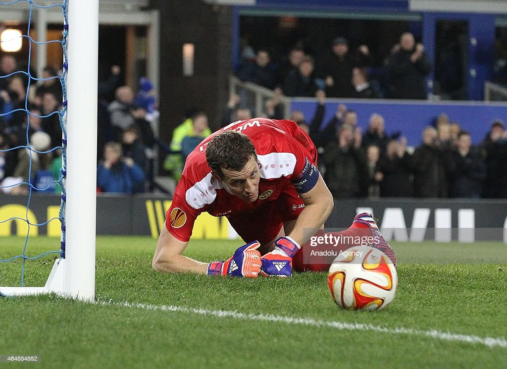 Young Boys' goalkeeper Marco Wolfli shows dejection after failing to save Everton's second goal during the UEFA Europa League round of 32 soccer match between Everton and Young Boys at Goodison Park stadium in Liverpool, England on February 26, 2015.