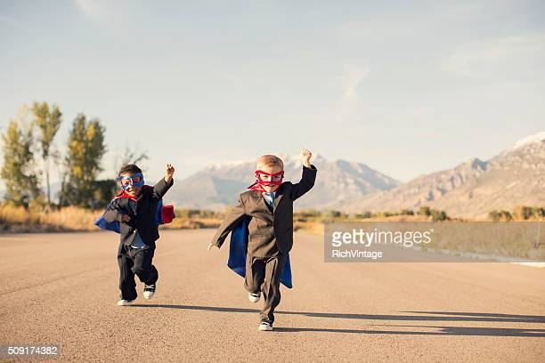 Young Boys in Superhero Costumes and Business Suits are Running