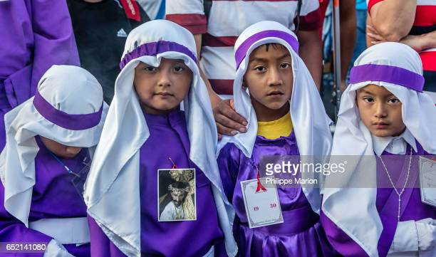 Young boys in traditional religious clothing during Holy Week in Antigua, Guatemala