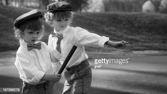 Young boys in vintage uniforms play golf : Stock Photo