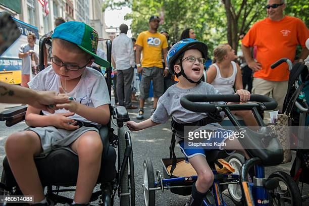 Young boys in wheelchairs participate in the first annual Disability Pride Parade on July 12 2015 in New York City The parade calls attention to the...