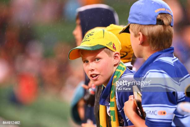 Young boys look on from the fenceline during The Rugby Championship match between the Australian Wallabies and the South Africa Springboks at nib...