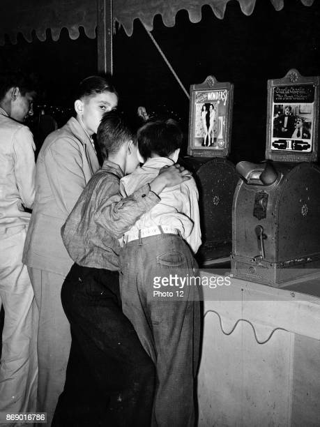 Young boys looking at nude dancer in the penny movies at south Louisiana state fair 1945