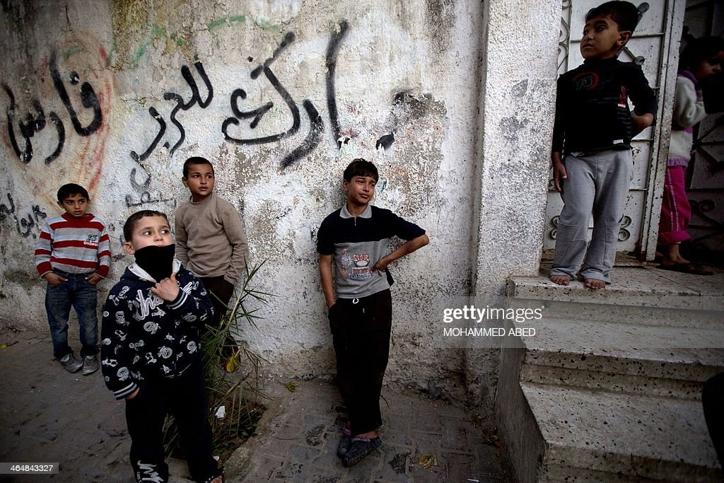 Young boys mourn during the funeral of Bilal Samir Oweida, a 20-year-old Palestinian, on January 24, 2014 in Beit Lahia, northern Gaza Strip. Bilal Samir Oweida was 'shot in the chest by Israeli soldiers' east of Jabaliya said Ashraf al-Qudra, a spokesman for the Hamas-run health ministry as Israeli forces said he had entered 'a prohibited area'.