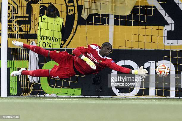 Young Boys' Namibian goalkeeper Yvon Mvogo takes the third goal during the UEFA Europa League round of 32 first leg football match between BCS...