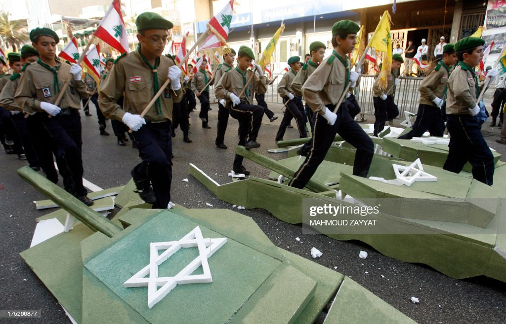 Young boys of Hezbollah's al-Mehdi scouts stomp on a polystyrene sheets designed to resemble an Israeli tank, during a parade in the Lebanese southern suburb of Nabatiyeh, on August 1, 2013, to mark the 'Al-Quds (Jerusalem) International Day'. An initiative started by Iranian revolutionary leader Ayatollah Ruhollah Khomeini, Quds Day is held annually on the last Friday of the Muslim fasting month of Ramadan and calls for Jerusalem to be returned to the Palestinians.