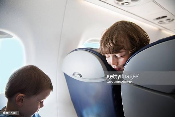 young boys on aeroplane