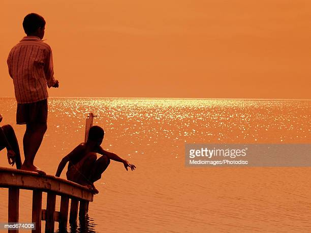 Young boys on pier in Santa Marta, Colombia, South America