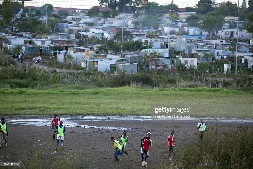 Young boys play a street soccer game on May 7 in the Motswaldi section in Soweto Johannesburg South Africa Thousands of young boys play soccer in...