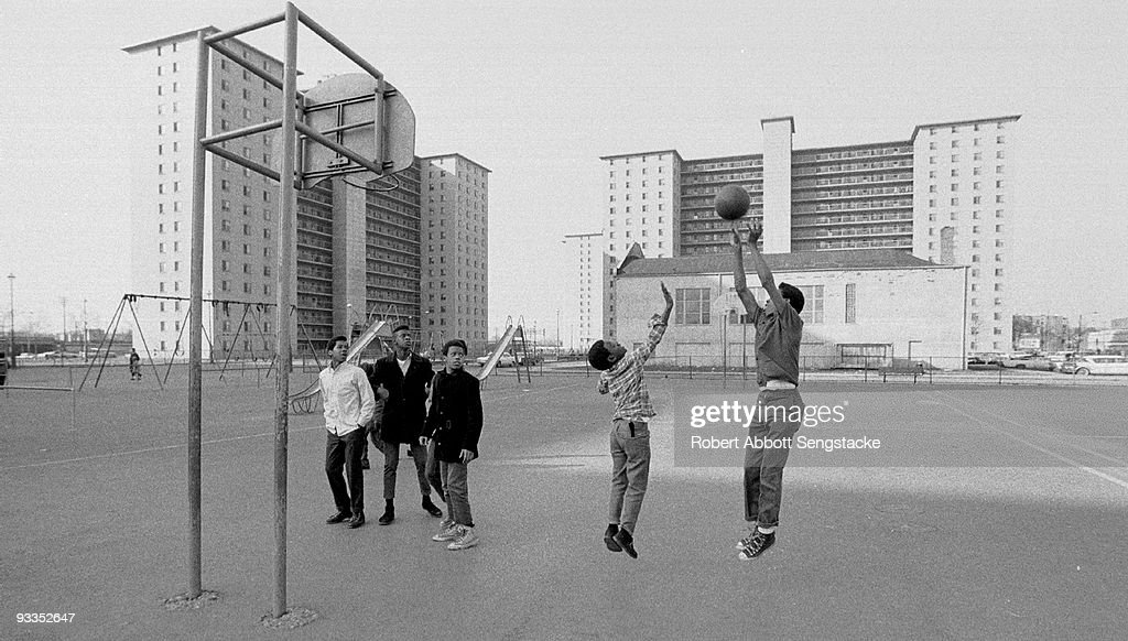 Young boys play basketball on a court located near the Robert Taylor housing projects in the Chicago neighborhood of Bronzeville, ca.1970s.
