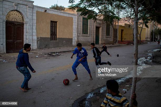 Young boys play soccer on the street in the poor neighbourhood of the 'City of the Dead' on December 14 2016 in Cairo Egypt The 'City of the Dead'...