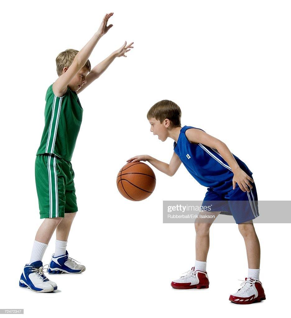 Young boys playing basketball