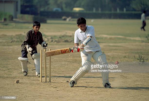 Young boys playing cricket in Lahore Pakistan 1st November 1994