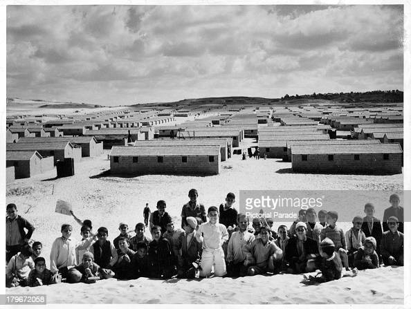 Young boys pose in front of the Jebalia refugee camp in Gaza Egypt