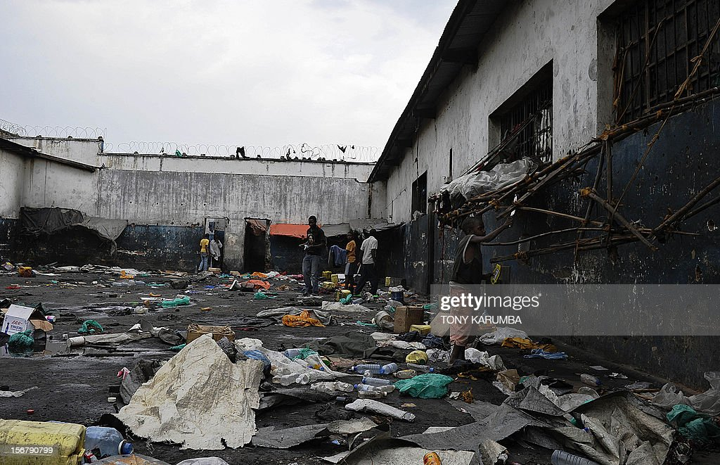 Young boys salvage building and other material from the yard of Muzenze prison on November 21, 2012 in Goma. Almost all inmates of Goma's main prison managed to break out after prison warders abandoned their positions to flee from advancing M23 rebels two days ago. The M23 rebel group in the Democratic Republic of Congo, which says it now controls all of Goma and nearby crossing points on the border with Rwanda vowed today it would not stop at Goma, after seizing the key eastern city this week. A spokesman for the M23 rebel group in the Democratic Republic of Congo called Wednesday for President Joseph Kabila to step down, saying he was not the legitimate winner of elections last year. AFP PHOTO/Tony KARUMBA