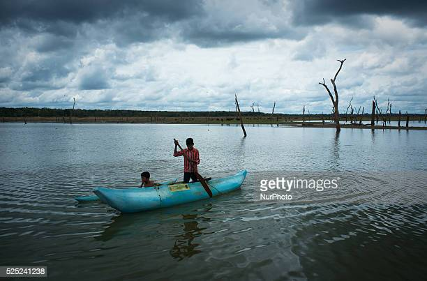 Young boys search for crawfish in a government donated boat in Northern Sri Lanka The boats are part of a reconciliation effort the government has...