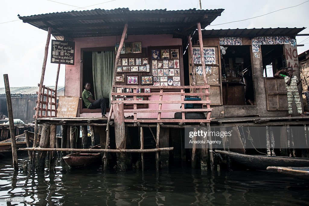 A young boys sits at a make shift studio in Makoko on April 30, 2014 in Lagos, Negeria. Makoko is slum neighborhood located in Nigeria, its population considered to be thousands moreover the area was not officially counted. Makoko slum is seldom visited by anyone from outside.