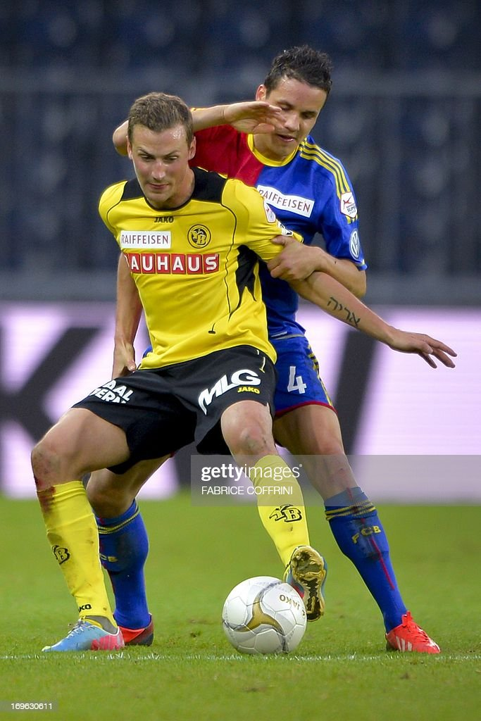 Young Boy's Swedish forward Alexander Gerndt (L) vies for the ball with FC Basel's defender Philipp Degen during the Swiss Super League football match Bern Young Boys vs FC Basel on May 29, 2013 in Bern.
