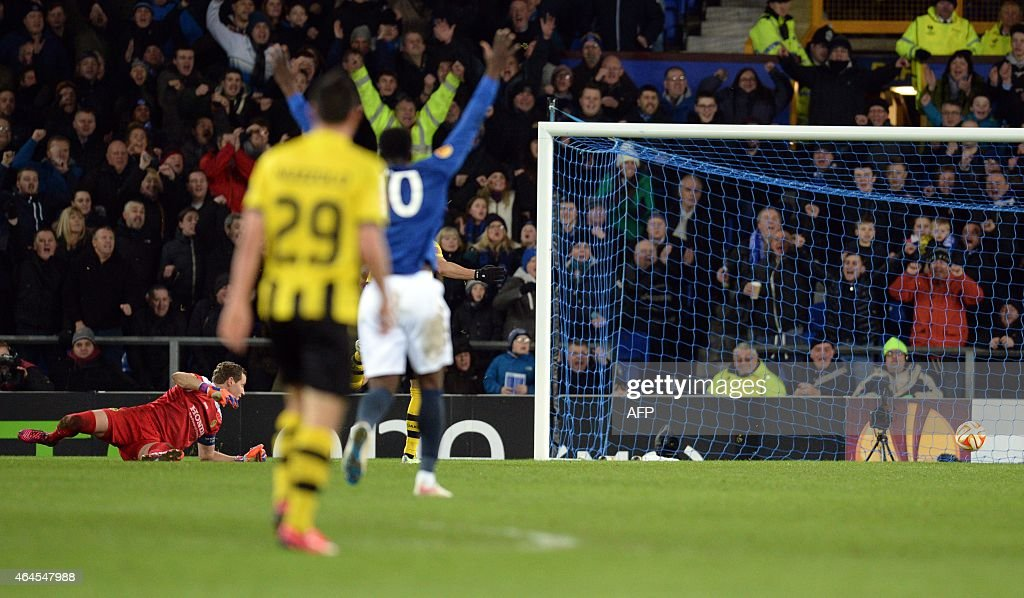 Young Boys' Swiss goalkeeper Marco Wolfli (L) misses the third goal for Everton scored by Everton's Belgian striker <a gi-track='captionPersonalityLinkClicked' href=/galleries/search?phrase=Kevin+Mirallas&family=editorial&specificpeople=745704 ng-click='$event.stopPropagation()'>Kevin Mirallas</a> (not pictured) during the UEFA Europa League round of 32 second leg football match between Everton FC and BSC Young Boys at the Goodison Park in Liverpool on February 26, 2015. Everton won the 3-1.