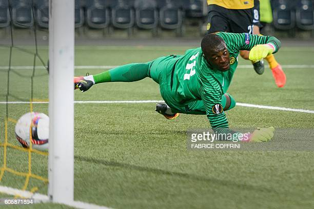 Young Boys' Swiss goalkeeper Yvon Mvogo takes the first goal during the UEFA Europa League group B football match beetween BSC Young Boys and...