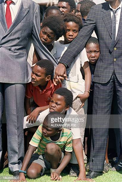Young boys try to see antiapartheid leader and African National Congress member Nelson Mandela at Orlando soccer stadium 12 February 1990 whilst...