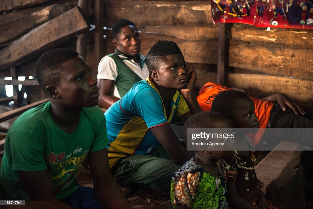 Young boys watch TV at a wooden building on April 30, 2014 in Lagos, Negeria. Makoko is slum neighborhood located in Nigeria, its population considered to be thousands moreover the area was not officially counted. Makoko slum is seldom visited by anyone from outside.
