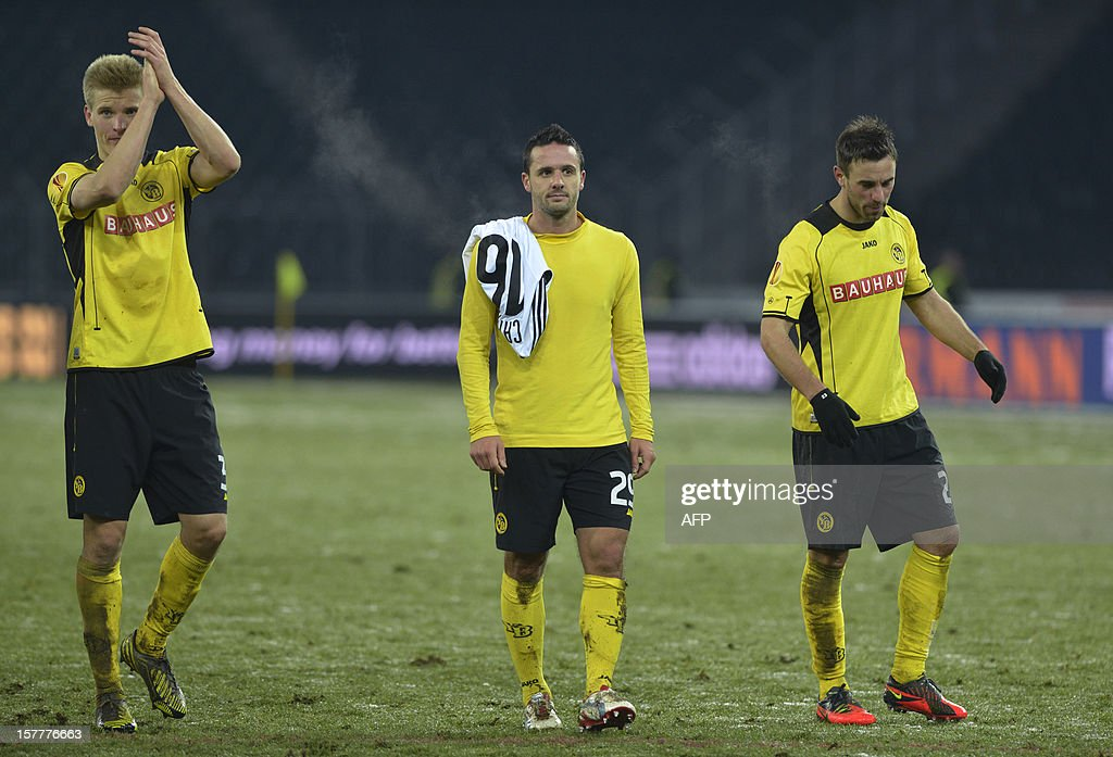 Young Boys'Juhani Ojala (L), Raphael Nuzzolo (C) and Scott Sutter (R) react at the end of their Europa League Group A football match between BSC Young Boys and FC Anji Makhachkala on December 6, 2012 in Bern. Despite winning the match the YoungBoys did not qualify for the next round of the Europa League championship.