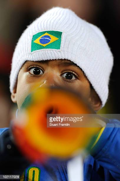 A young Brazil fan blows a vuvuzela prior to the 2010 FIFA World Cup South Africa Group G match between Brazil and North Korea at Ellis Park Stadium...
