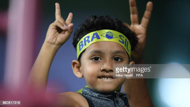 A young Brazil fan shows his support during the FIFA U17 World Cup India 2017 Round of 16 match between Brazil and Honduras at the Jawaharlal Nehru...