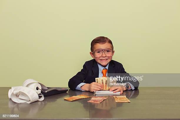 Young Brazilian Boy Accountant with Money