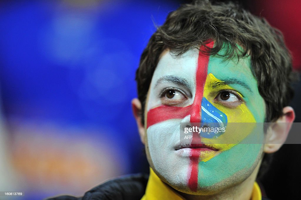 A young Brazilian supporter with a painted face looks on from the crowd before the international friendly football match between England and Brazil at Wembley Stadium in north London on February 6, 2013.