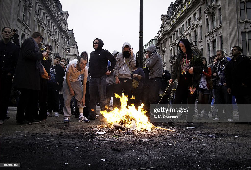 CONTENT] Young breakaway protesters (some of them hooded anarchists) start a bonfire in the middle of London's busiest shopping area, Oxford Street. This was during a big anti-cuts march through Central London that day. Damage was inflicted on businesses deemed to be tax avoiders and iconic symbols of globalisation. This is late afternoon on March 26, 2011.