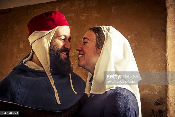 A young bride and groom smiling at each other Central Italy mid14th century Historical reenactment