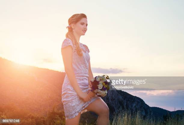 Young bride at sunset in nature