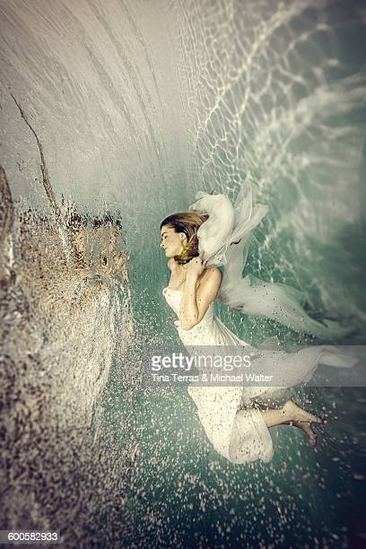 Young bride dancing underwater