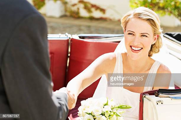 Young Bride In Getting Off From Convertible Car