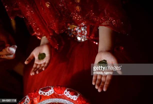 A young bride receives henna tattoos during a Macedonian indigenous Juruk tribe wedding in Pochival Village near Stip Macedonia on September 9 2017...