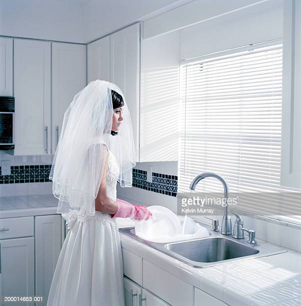 Young bride washing dishes