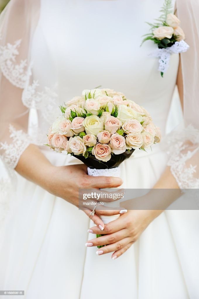 young bride with bouquet of white roses : Stock Photo