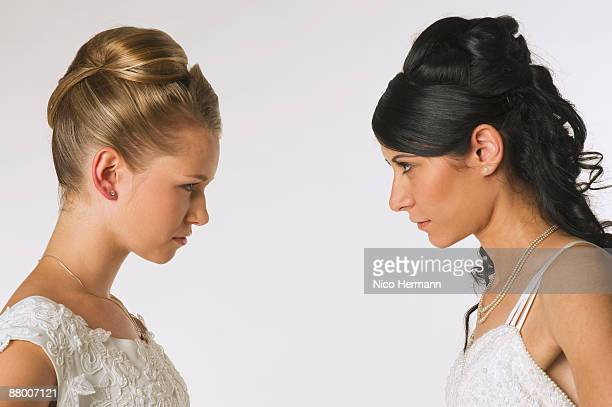 Young brides standing face to face, portrait